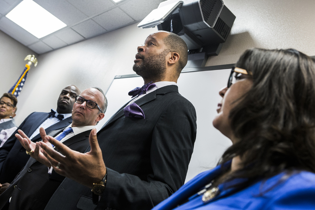 Sen. Aaron Ford, second from left,  speaks during a news conference discussing benefits for employment at the stadium project, Thursday, Oct. 27, 2016, at the Urban Chamber of Commerce in North La ...
