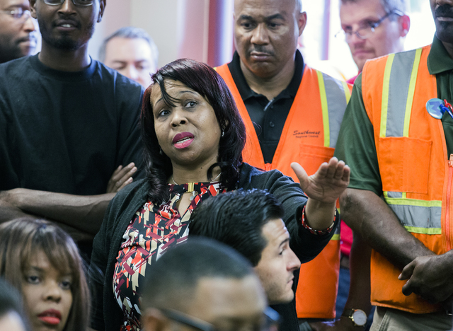 Sheila Collins asks about community benefits in the 89106 zip code during a news conference discussing benefits for employment at the stadium project at the Urban Chamber of Commerce in North Las  ...