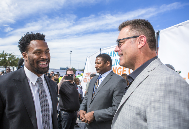 NFL running back Steven Jackson, left, talks to former Oakland Raider defensive end Howie Long during a rally in support of the $1.9 billion, 65,000-seat domed stadium Monday, Oct. 3, 2016, at Tho ...