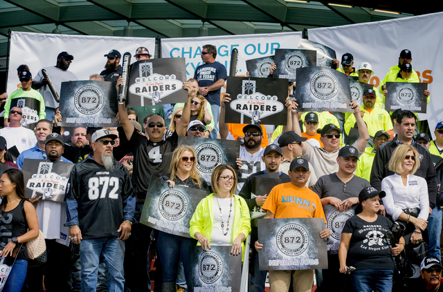Supporters of the $1.9 billion, 65,000-seat domed stadium stand for a photo during a rally Monday, Oct. 3, 2016, at Thomas and Mack Center.  (Jeff Scheid/Las Vegas Review-Journal) Follow @jeffscheid
