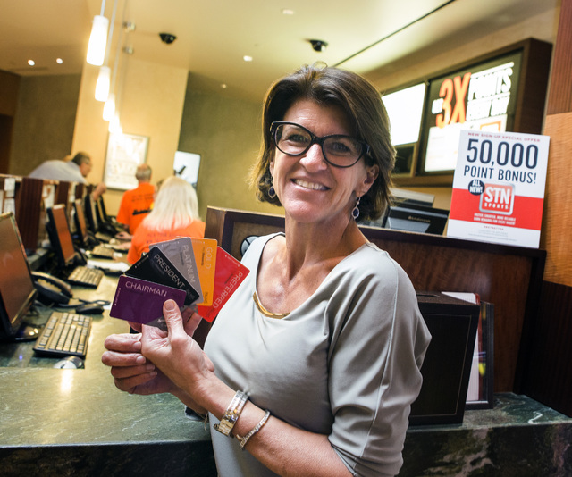 Station Casinos executive Staci Alonso, executive vice president of innovation and administration, holds a variety of Station Casinos loyalty cards, Tuesday, Oct. 25, 2016, at Red Rock Resort. Beg ...