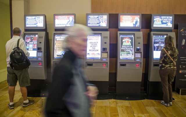People use the Boarding Pass kiosks, Tuesday, Oct. 25, 2016, at Red Rock Resort. Beginning Nov. 1, Station Casinos will offer points for gaming, dining, spa and hotel spent at its properties. Jeff ...