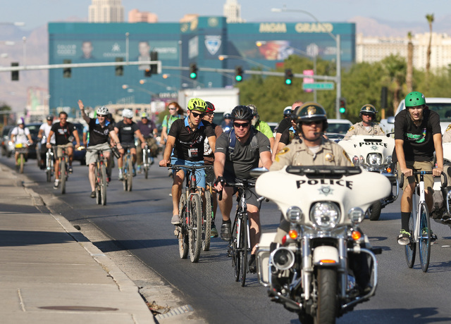 Cyclists ride along Tropicana Avenue to Gene Ward Elementary School in southwest Las Vegas carrying books in backpacks during the sixth annual Ride for Reading event Sept. 22, 2016. Better World B ...