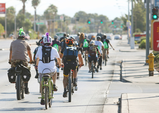 Cyclists ride along Tropicana Avenue to Gene Ward Elementary School in southwest Las Vegas carrying books in backpacks during the sixth annual Ride for Reading event Sept. 22, 2016. Ronda Churchil ...