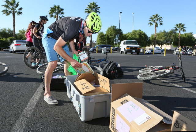 Taylor Ross of Denver fills a pack with books at Mandalay Bay before riding in the sixth annual Ride for Reading event Sept. 22, 2016. Ronda Churchill/View