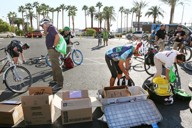 Cyclists and coordinators prepare for the start of the sixth annual Ride for Reading event at a staging area at Mandalay Bay Sept. 22, 2016. Ronda Churchill/View