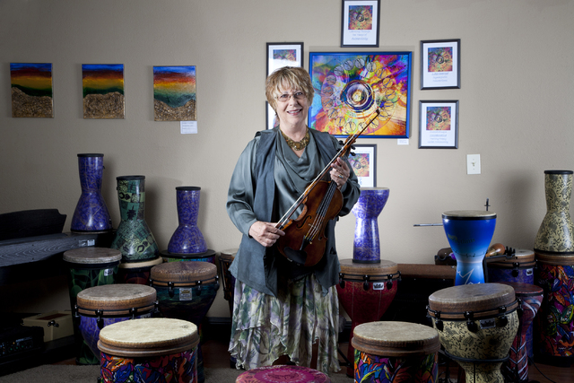 Music4Life music therapist Judith Pinkerton plays the violin in her studio on South Rainbow Boulevard in Las Vegas Sept. 16. Jeferson Applegate/View