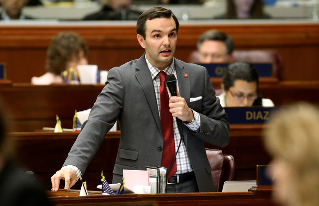 Nevada Assemblyman Derek Armstrong, R-Las Vegas, speaks in support of Gov. Brian Sandoval's $1.1 billion tax plan during the Assembly floor debate at the Legislative Building in Carson City, Nev., ...