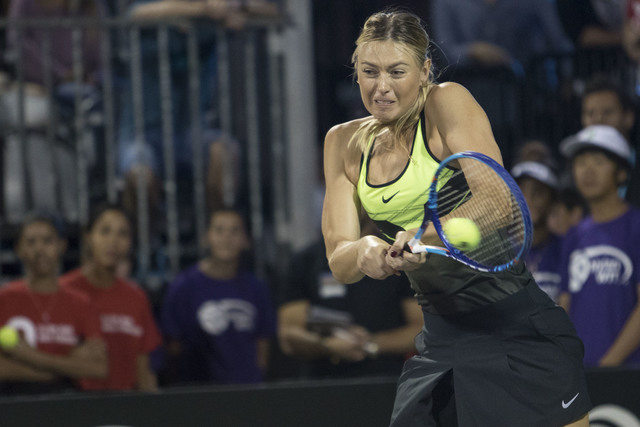 Maria Sharapova returns a ball as she plays during the WTT Smash Hits charity tennis event at Caesars Palace in Las Vegas on October, 10, 2016.  Richard Brian/Las Vegas Review-Journal Follow @vega ...