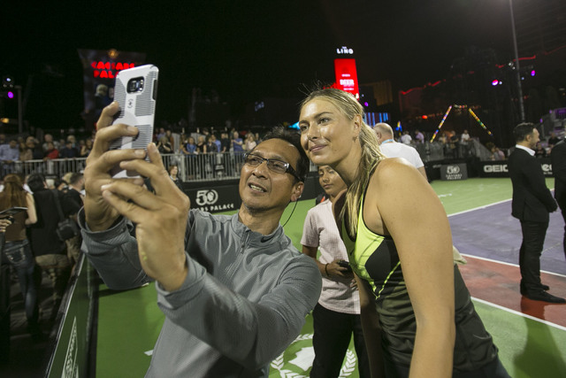 Maria Sharapova, right, poses with a fan after playing in the WTT Smash Hits charity tennis event at Caesars Palace in Las Vegas on October, 10, 2016. Richard Brian/Las Vegas Review-Journal Follow ...