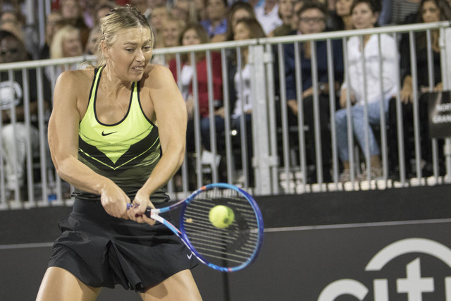 Maria Sharapova returns a ball as she plays during the WTT Smash Hits charity tennis event at Caesars Palace in Las Vegas on October, 10, 2016. Richard Brian/Las Vegas Review-Journal Follow @vegas ...