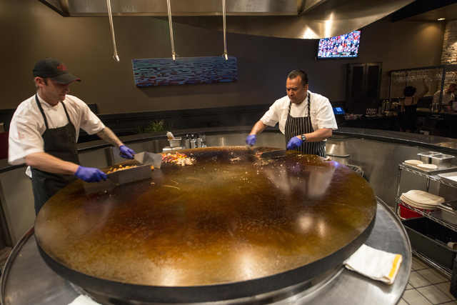 Nick Brozan, left, and Baltazar Troncoso, executive chef, use the center grill at The Mixx Grill & Lounge in Boca Park in Las Vegas on Friday, Oct. 7, 2016. Jacob Kepler/Las Vegas Review-Journal
