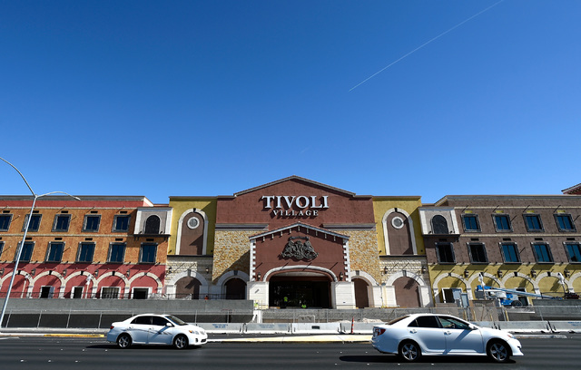 Vehicle traffic travels along Rampart Boulevard near Tivoli Village, Friday, Oct. 21, 2016, in Las Vegas. An additional 350,000 square-foot of retail and office space is schedule to open at the sh ...