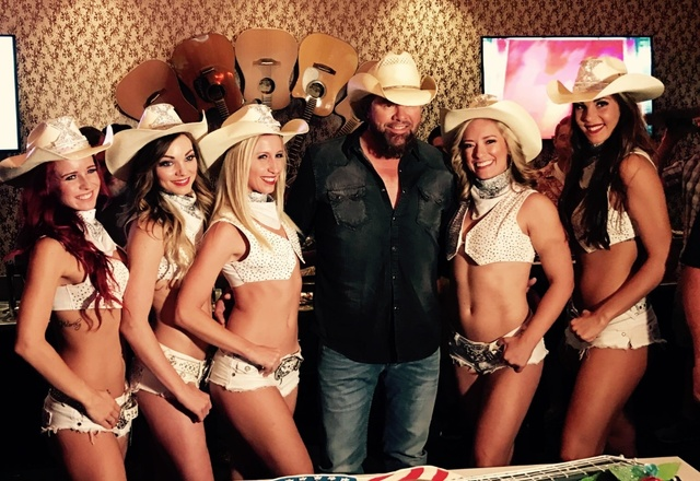 "Toby Keith meets the women of topless show ""X Country"" at Harrah's. (Courtesy)"