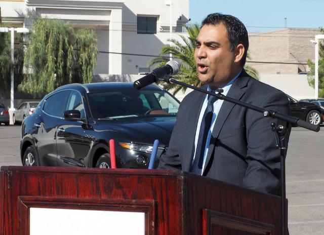 Nasif Siddiqi, Masarati regional vice president, talks about the new Ferrari/Masarati dealership at Towbin Motorcars on Sahara Avenue in Las Vegas, Tuesday, Oct. 18, 2016. Behind him is a Masarati ...