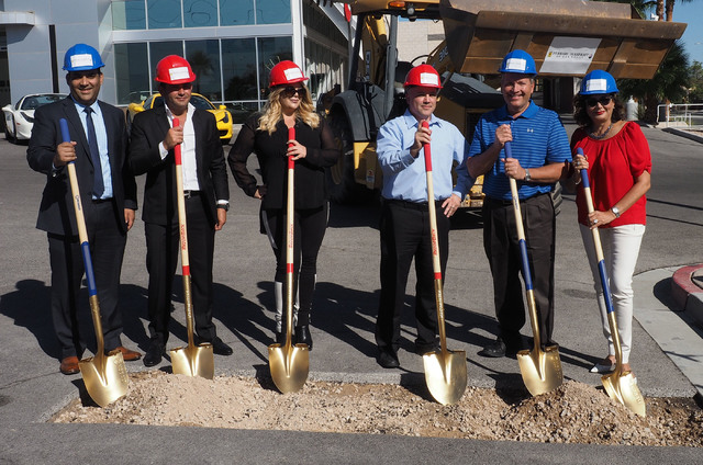 Nasif Siddiqi, Rony Mansour, Jesika Towbin-Mansour, Derrick Williams, Boyd Martin and Carolyn Towbin, left to right, take part in the groundbreaking at the new Ferrari/Masarati dealership at Towbi ...