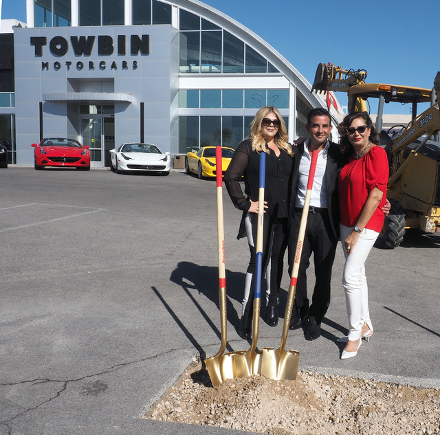 Jesika Towbin-Mansour, her husband, Rony Mansour, and Carolynn Towbin, left to right, pose at the new Towbin Ferrari/Masarati dealership on Sahara Avenue in Las Vegas, Tuesday, Oct. 18, 2016. (Jer ...