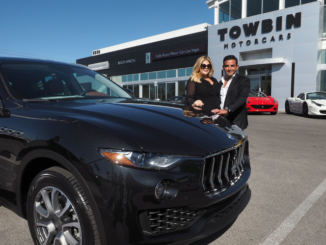 Jesika Towbin-Mansour and her husband, Rony Mansour, pose at the new Towbin Ferrari/Masarati dealership on Sahara Avenue in Las Vegas, Tuesday, Oct. 18, 2016. They are standing next to a new Masar ...