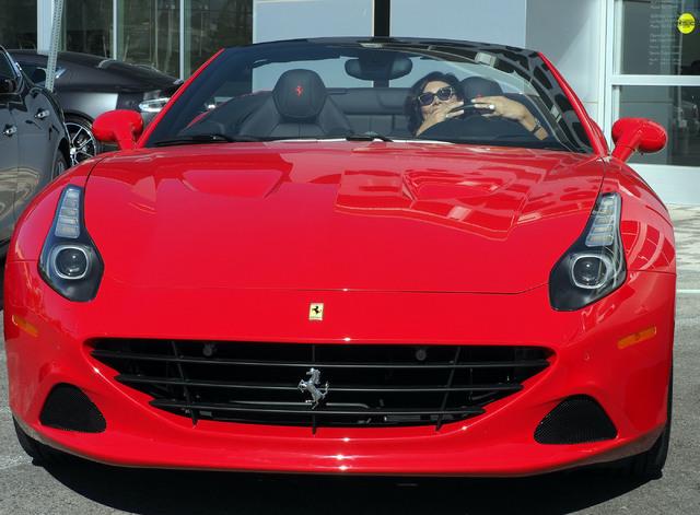 Carolynn Towbin poses with a 2016 Ferrari California T at the new Towbin Ferrari/Masarati dealership on Sahara Avenue in Las Vegas, Tuesday, Oct. 18, 2016. They are standing next to a new Masarati ...