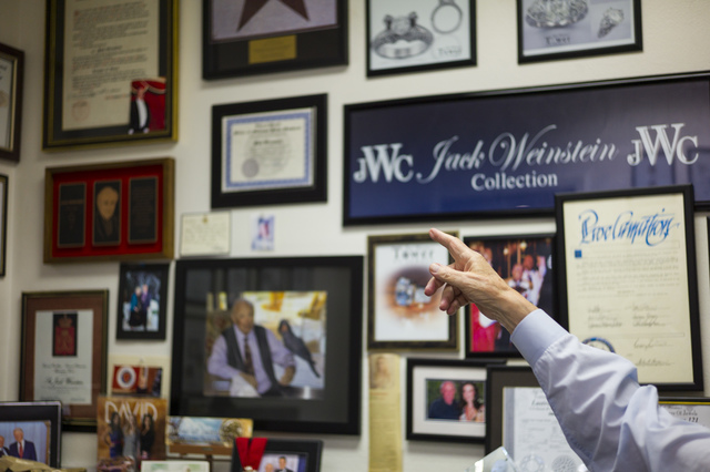 Jeweler Jack Weinstein, who opened Tower of Jewels in 1964, points to memorabilia while being interviewed ahead of his slated retirement at the store in Las Vegas on Thursday, Oct. 13, 2016. (Chas ...