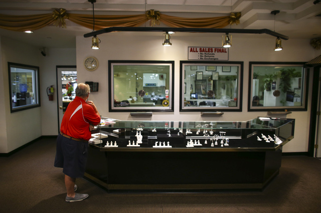 A customer looks through items at Tower of Jewels in Las Vegas on Thursday, Oct. 13, 2016. (Chase Stevens/Las Vegas Review-Journal) Follow @csstevensphoto