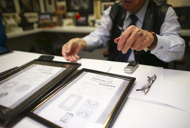 Jeweler Jack Weinstein, who opened Tower of Jewels in 1964, shows diamond patents during an interview ahead of his slated retirement at the store in Las Vegas on Thursday, Oct. 13, 2016. (Chase St ...