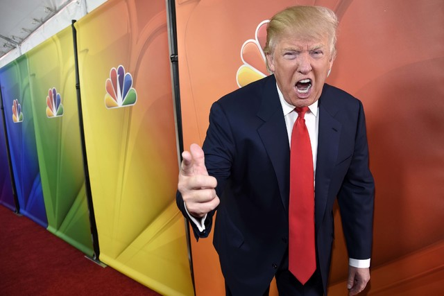 "Donald Trump, host of the television series ""The Celebrity Apprentice,"" mugs for photographers at the NBC 2015 Winter TCA Press Tour in Pasadena, Calif., Jan. 16, 2015. (Chris Pizzello/Invision/AP ..."