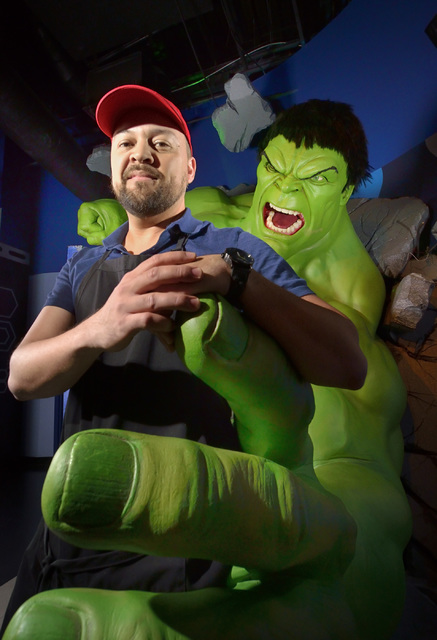 Lead studio artist Adam Morey gets a hand from Marvel Comics' Incredible Hulk, the largest wax figure at Madame Tussauds Las Vegas. Unlike the human figures, who are painted with oil paints, the H ...