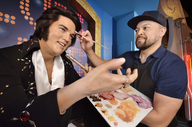 Lead studio artist Adam Morey demonstrates his touch-up technique on an Elvis figure at Madame Tussauds Las Vegas. He arrives at The Venetian attraction at 7 a.m. to prepare the wax likenesses to  ...