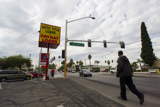 A man passes by Nevada Title Loans off Las Vegas and Charleston boulevards in downtown Las Vegas on Friday, Oct. 28, 2016. Chase Stevens/Las Vegas Review-Journal Follow @csstevensphoto