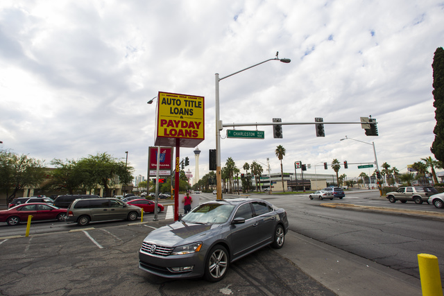 A car drives into the lot for Nevada Title Loans off Las Vegas and Charleston boulevards in downtown Las Vegas on Friday, Oct. 28, 2016. Chase Stevens/Las Vegas Review-Journal Follow @csstevensphoto
