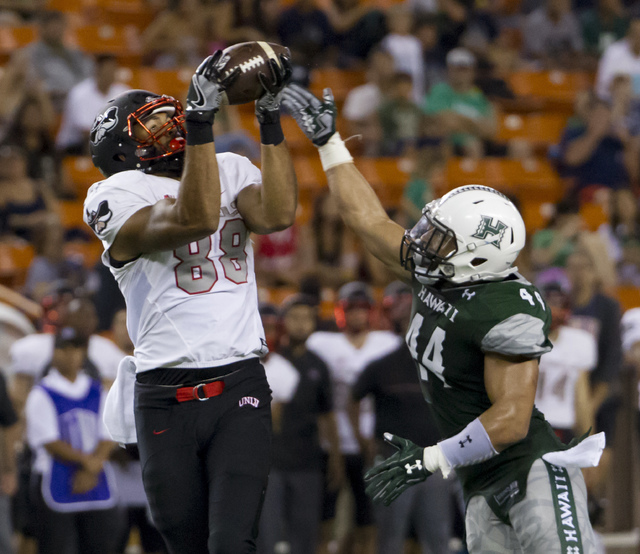 UNLV tight end Andrew Price (88) catches a pass while defended by Hawaii linebacker Russell Williams Jr. (44) during the second quarter of an NCAA college football game, Saturday, Oct. 15, 2016, i ...