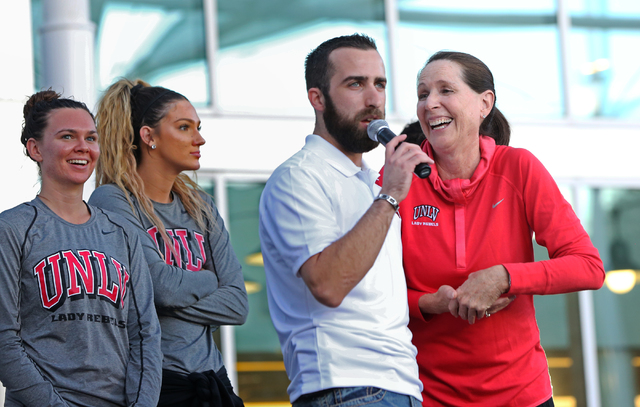 UNLV women's head coach Kathy Olivier, right, jokes with event host Jersey Goldman during a meet and greet with the UNLV men's and women's basketball teams outside the UNLV Student Union Center on ...