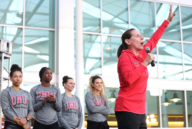 UNLV women's head coach Kathy Olivier, right, fires up the crowd during a meet and greet with the UNLV men's and women's basketball teams outside the UNLV Student Union Center on Wednesday, Oct. 2 ...