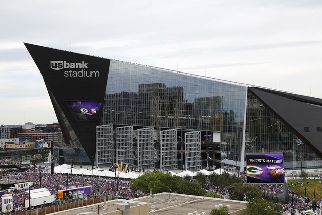 Fans arrive at U.S. Bank Stadium before an NFL football game between the Minnesota Vikings and the Green Bay Packers Sunday, Sept. 18, 2016, in Minneapolis. (AP Photo/Andy Clayton-King)