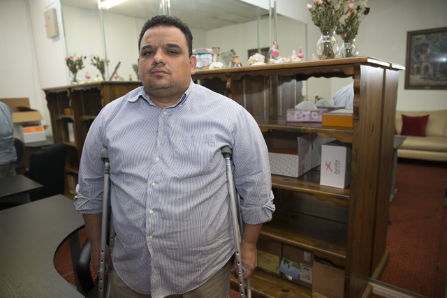 Pastor Andres Charry-Arana is photographed at his church, Iglesia Ministerio Cristiano Misericordia y Verdad, on Thursday, Sept. 29, 2016, in Las Vegas. Pastor Charry-Arana was attacked by Walter  ...