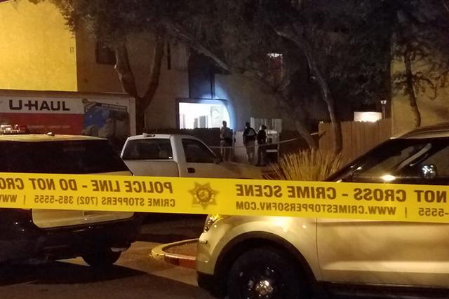 Las Vegas police investigate a homicide Thursday at the Virginia Apartments in Las Vegas. (Mike Shoro/Las Vegas Review-Journal)