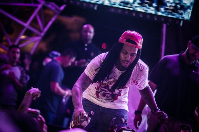 Waka Flocka pours booze in revelers' mouths at club Eclipse. (Courtesy)