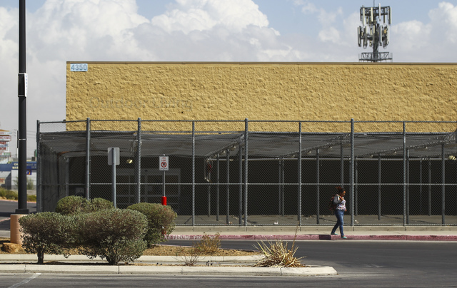 A woman crosses through the parking lot of a former Walmart location at 4350 N. Nellis Blvd. in Las Vegas on Thursday, Sept. 22, 2016. Chase Stevens/Las Vegas Review-Journal Follow @csstevensphoto