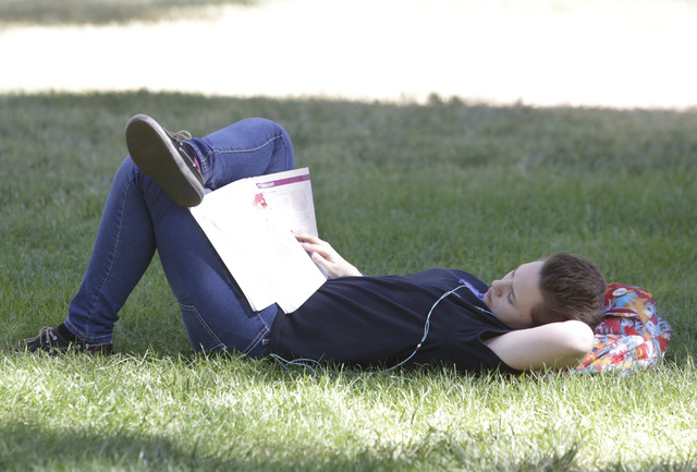 UNLV student Mikayla Dellinger, takes advantage of the cool weather to relax and study Thursday, Oct. 6, 2016, at her campus. The Las Vegas Valley will see sunny skies and slight breezes until the ...