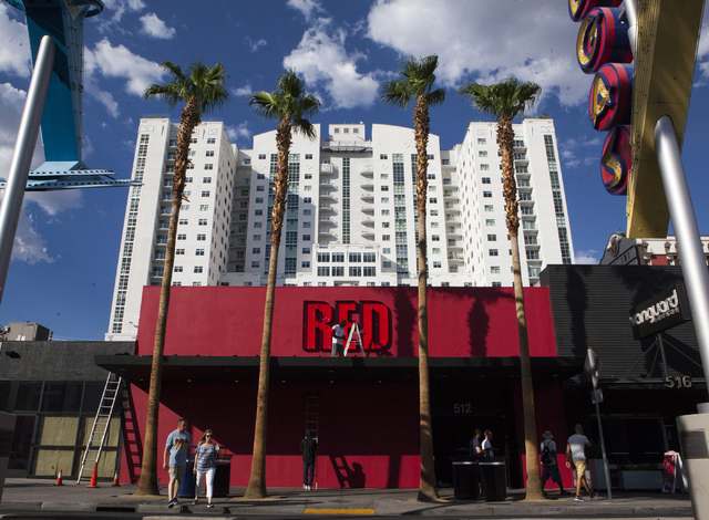 Construction workers are seen working on the outside of Red video bar which took over the space Insert Coin(s) once occupied in downtown Las Vegas, Thursday Sept. 1, 2016. (Miranda Alam/Las Vegas  ...