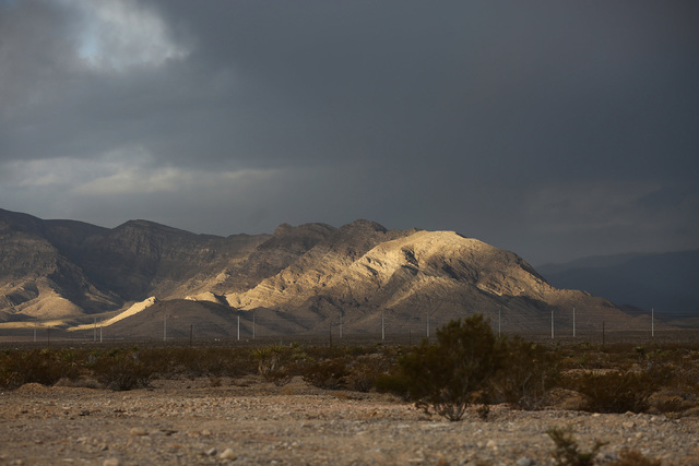 A break in the clouds allows a swath of light to accent a ridge on the the west side of Las Vegas Valley on Friday, Oct. 28, 2016. (Brett Le Blanc/Las Vegas Review-Journal Follow @bleblancphoto)