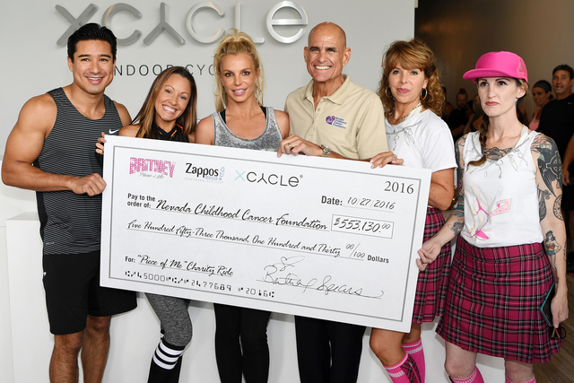 Check presentation to NCCF with Mario Lopez, Jen Barnet, Britney Spears, Jeff Gordon, Stephanie Parker and Anna Laufenburger. (Denise Truscello)