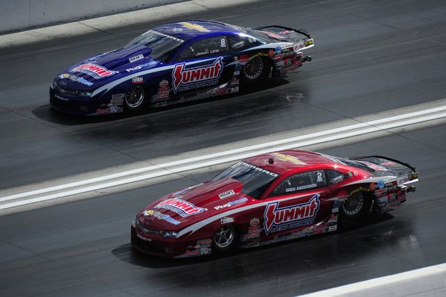NHRA Mello Yello Series Pro Stock drivers Greg Anderson (red) and Jason Line race each other during qualifying for the Toyota NHRA Nationals at The Strip at Las Vegas Motor Speedway in Las Vegas F ...