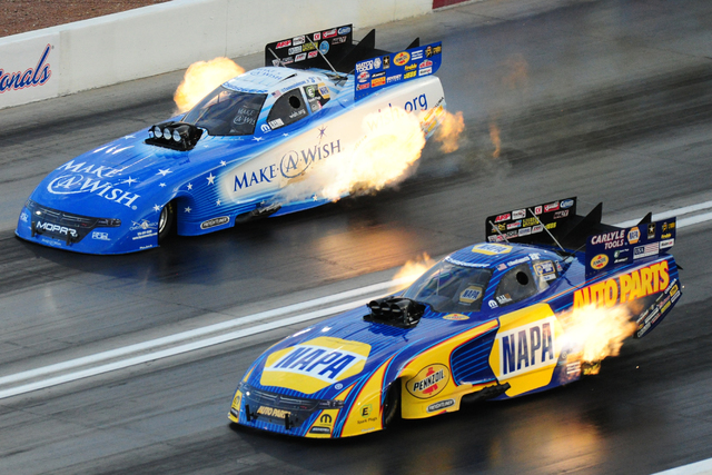 Funny Car drivers Ron Capps, nottom, and Tommy Johnson Jr. race side by side during qualifying for the NHRA Mello Yello Series Toyota Nationals at The Strip at Las Vegas Motor Speedway in Las Vega ...