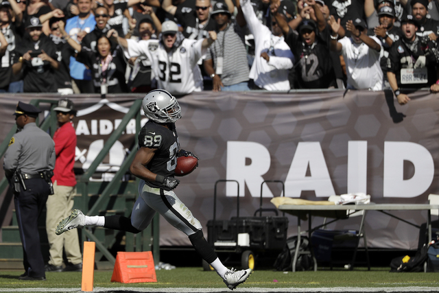 Oakland Raiders wide receiver Amari Cooper (89) scores on a touchdown reception during the second half of an NFL football game against the San Diego Chargers in Oakland, Calif., Sunday, Oct. 9, 20 ...