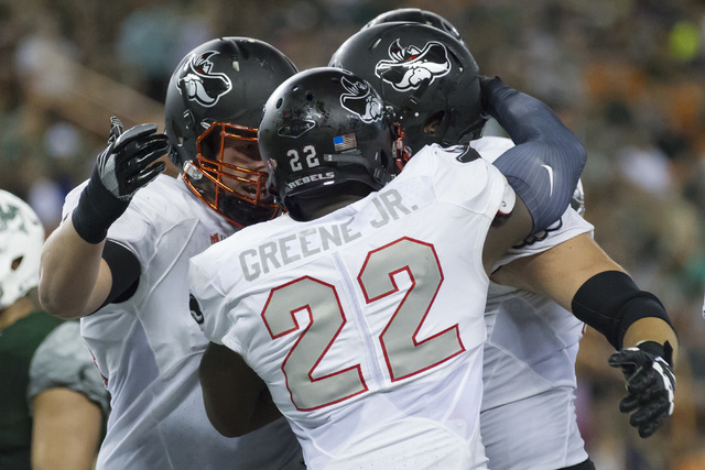 UNLV running back David Greene (22) is congratulated by teammates after scoring a touchdown late in the second quarter of an NCAA college football game against Hawaii, Saturday, Oct. 15, 2016, in  ...