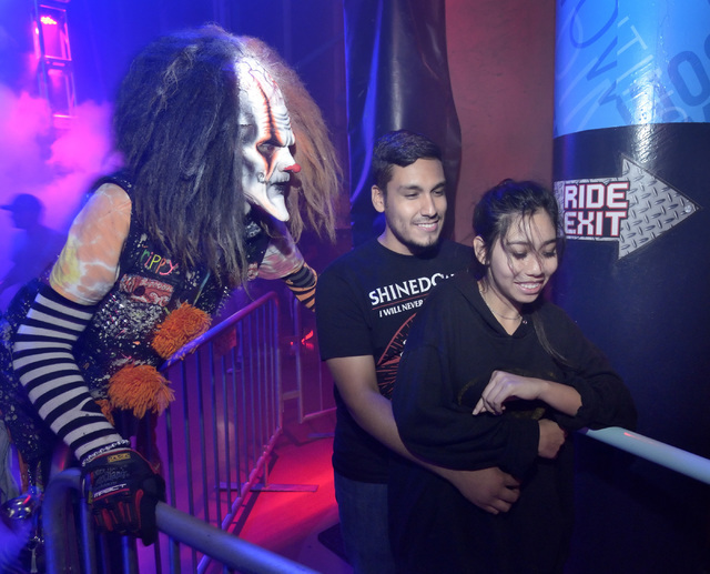 Julian Carrabis, at Trippy the Clown scares Morian Gutierrez and Amritjeet Raju in the Fright Dome at Adventuresome in the Circus Circus hotel-casino on Sunday Oct. 16, 2016. (Bill Hughes/Las Vega ...