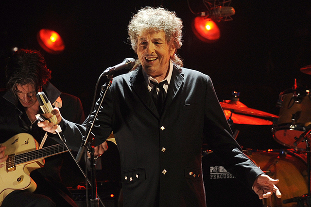 In this Jan. 12, 2012, file photo, Bob Dylan performs in Los Angeles. Dylan was named the winner of the 2016 Nobel Prize in literature Thursday, Oct. 13, 2016, in a stunning announcement that for  ...