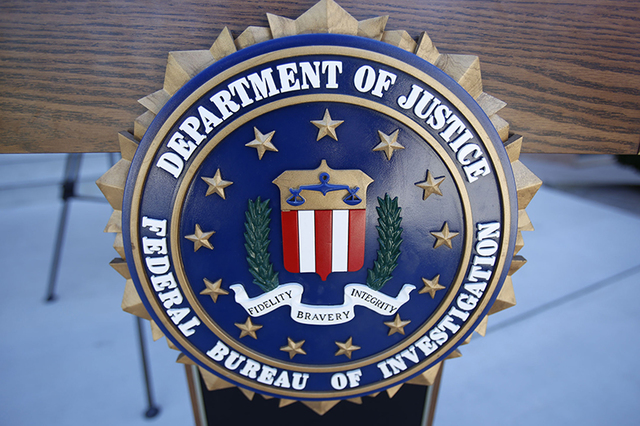 An FBI podium is shown during a press conference outside the main entrance of City Hall in Boulder City, Nevada on Friday, Sept. 16, 2016. (Richard Brian/Las Vegas Review-Journal)